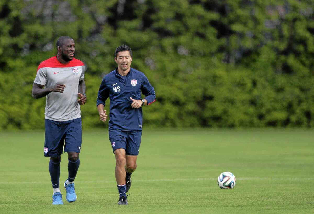 The United States' Jozy Altidore, left, works out with trainer Masa Sakihana during a session Saturday in Sao Paulo, Brazil.