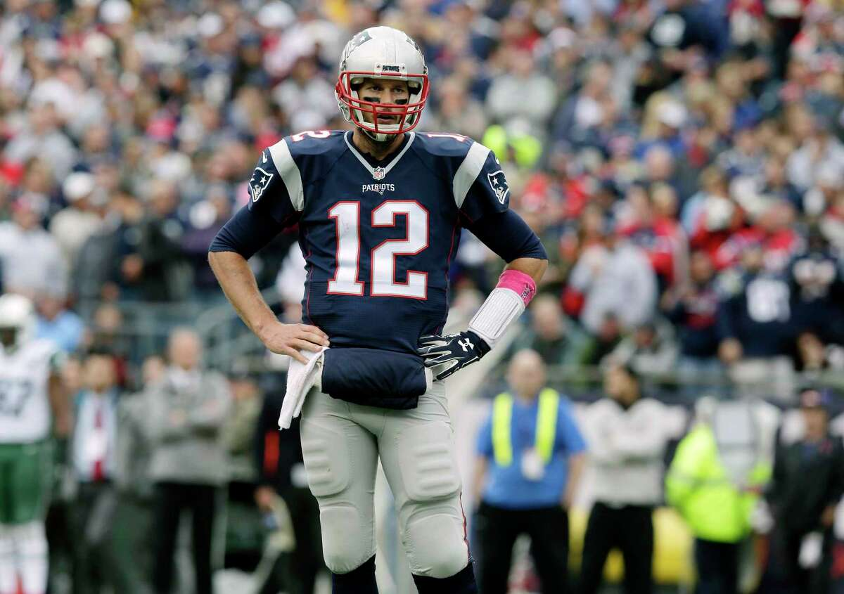 New England Patriots quarterback Tom Brady stands on the field during the first half Sunday in Foxborough, Mass.