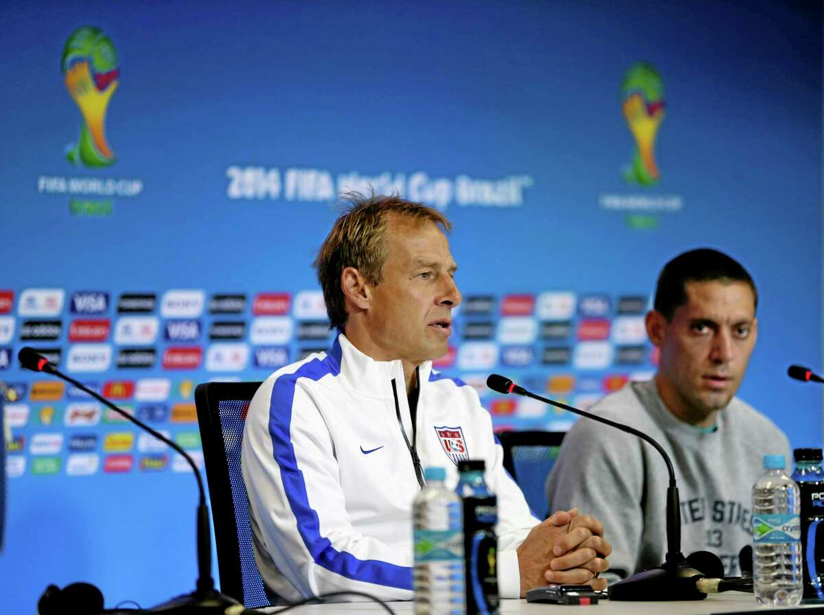 United States head coach Jurgen Klinsmann, left, speaks during a press conference Monday before a World Cup Round of 16 match against Belgium Tuesday at Arena Fonte Nova in Salvador, Brazil. At right is attacker Clint Dempsey.