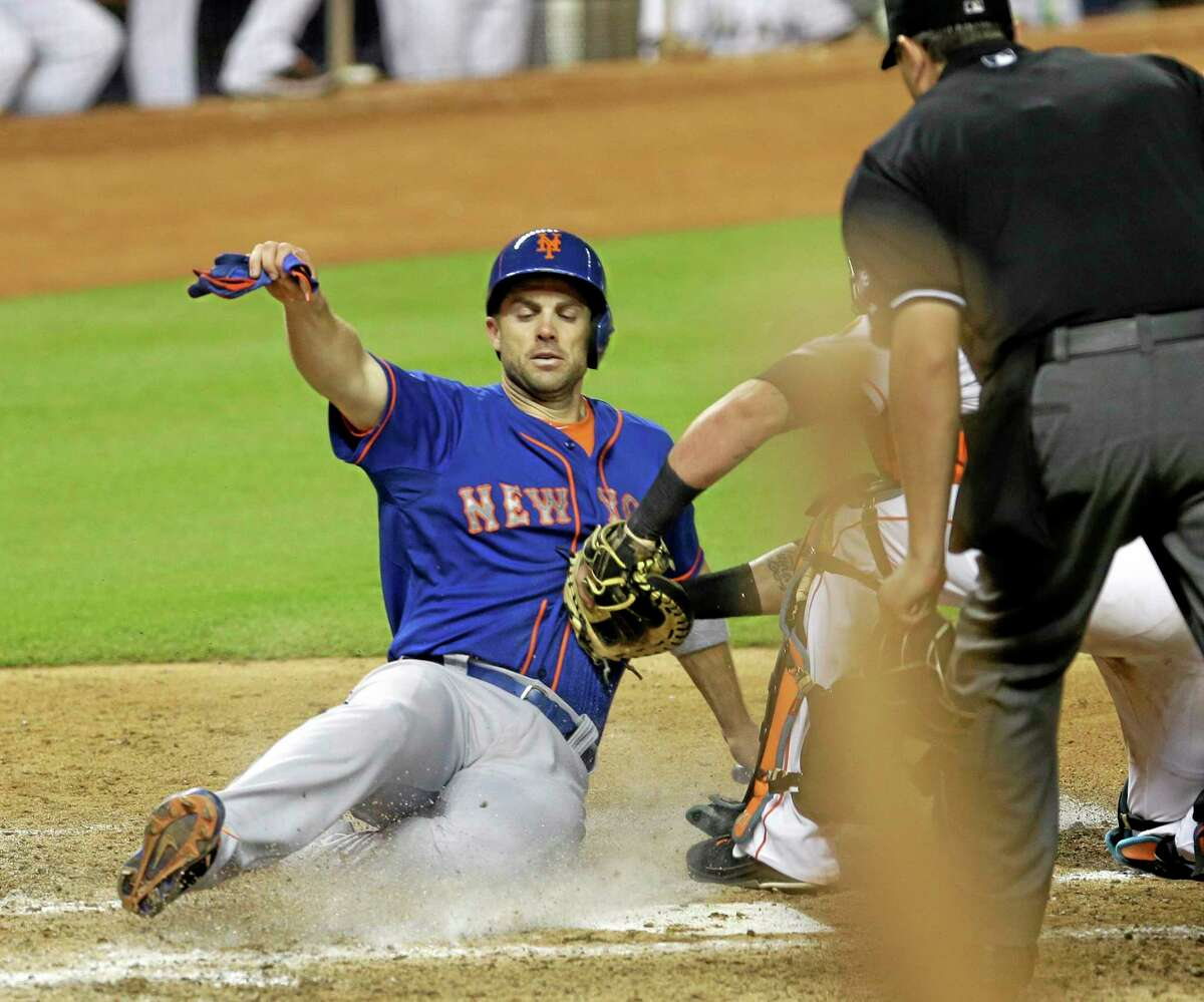 The New York Mets' David Wright, left, is tagged out at home by Marlins catcher Jarrod Saltalamacchia during a June 20 game in Miami.