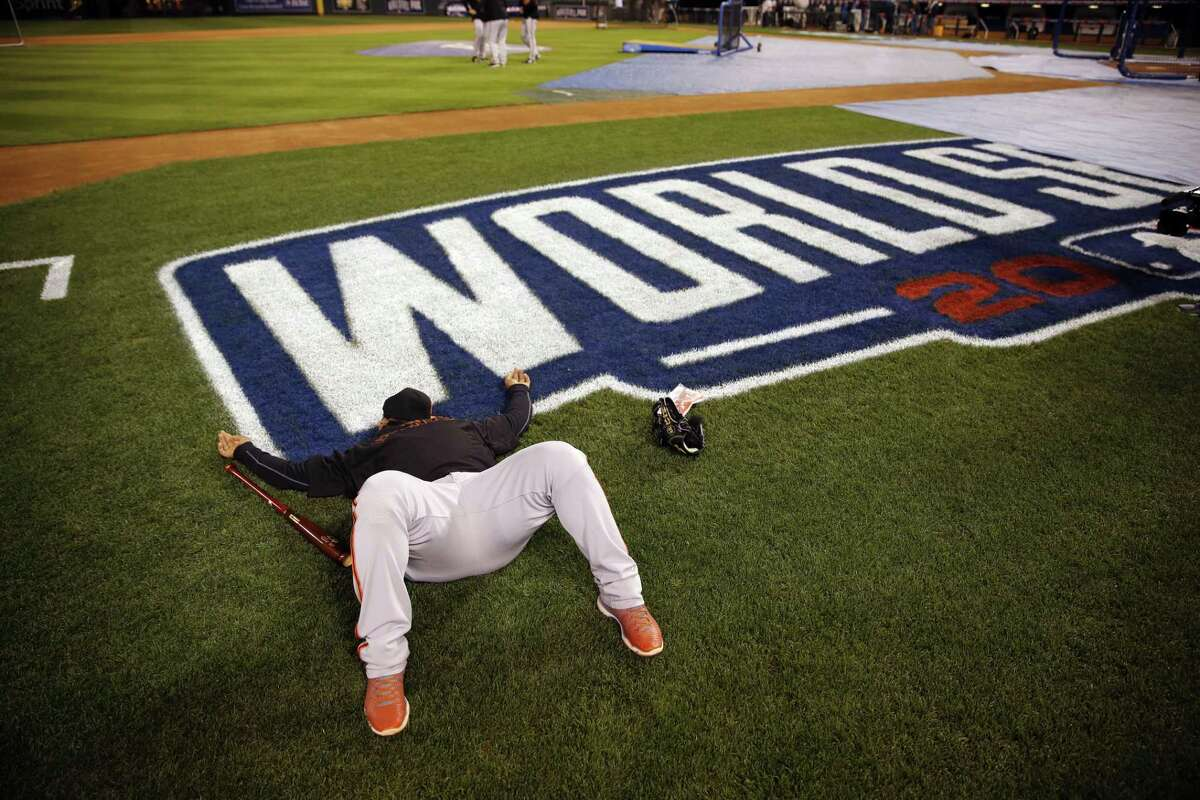 San Francisco Giants third baseman Pablo Sandoval lays down shortly after arriving at Kauffman Stadium for a workout Monday in Kansas City, Mo.