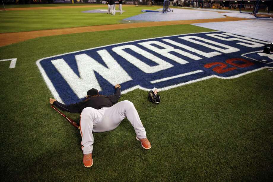 San Francisco Giants third baseman Pablo Sandoval lays down shortly after arriving at Kauffman Stadium for a workout Monday in Kansas City, Mo. Photo: Jeff Roberson — The Associated Press  / AP