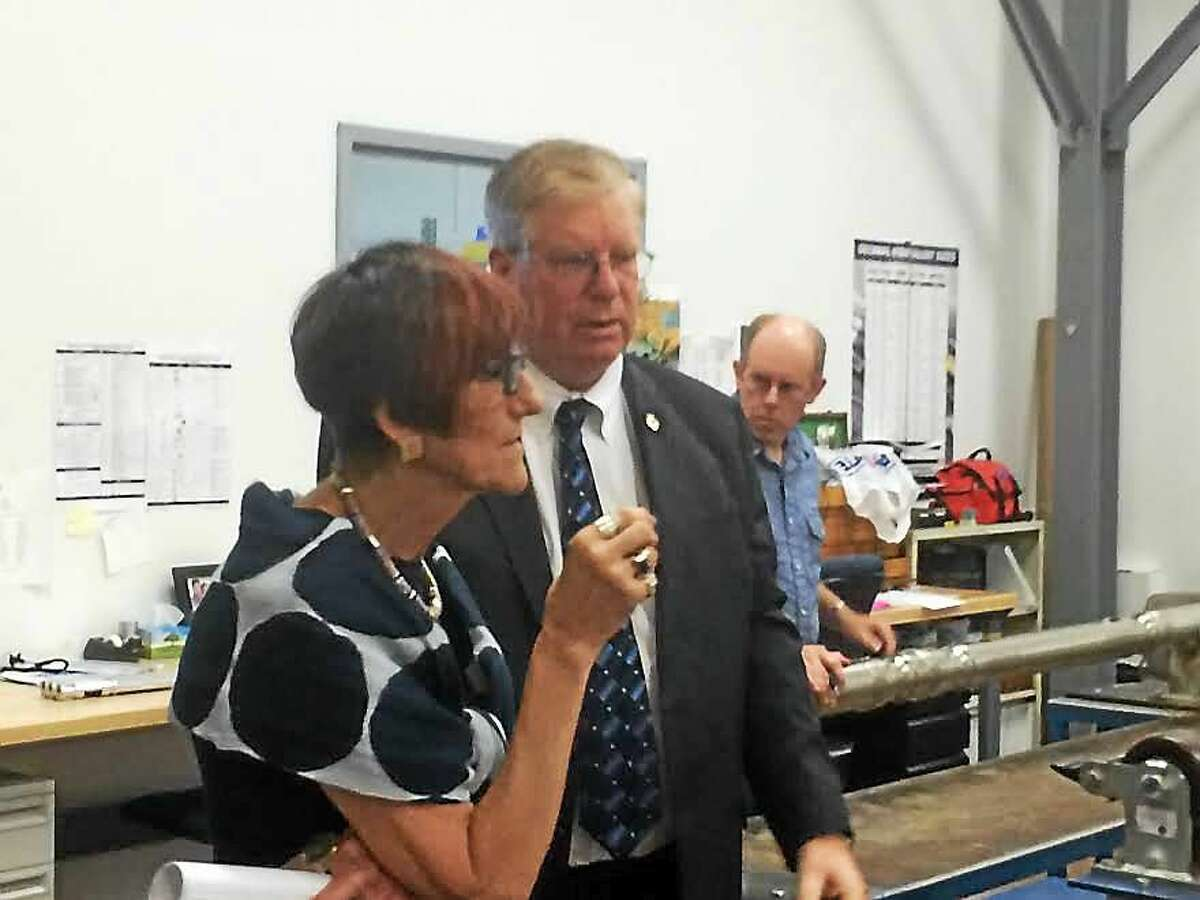U.S. Rep. Rosa L. DeLauro, D-3, tours APS Technology in Wallingford Tuesday with William Turner, the company's chief executive officer.