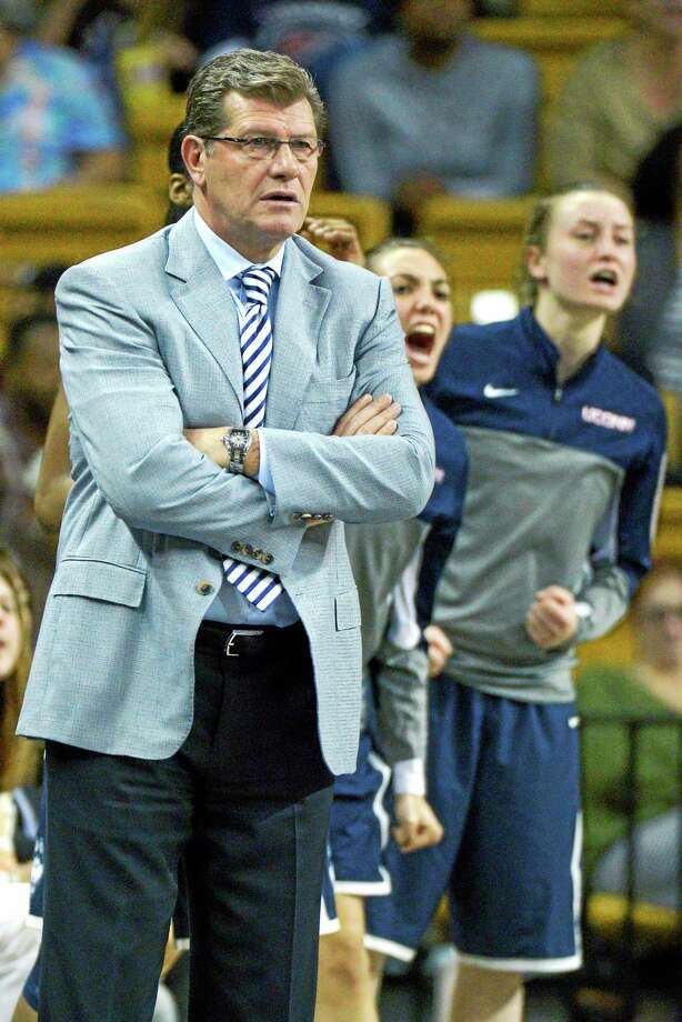 UConn coach Geno Auriemma, left, has awarded scholarships to walk-ons Briana Pulido, center, and Ansonia's Tierney Lawlor, right. Photo: Phelan M. Ebenhack — The Associated Press File Photo  / FR121174 AP