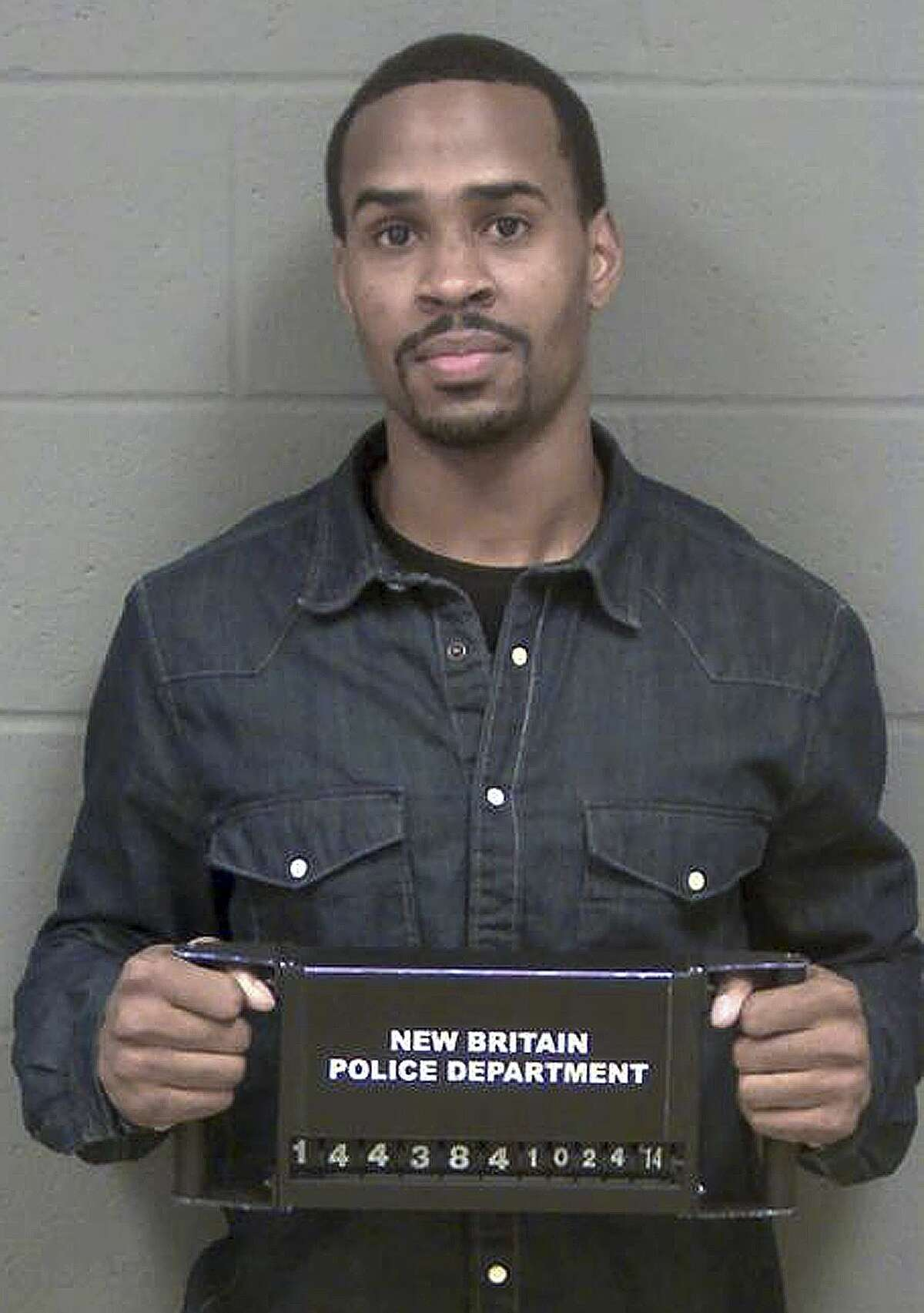 Central Connecticut State basketball player Kyle Vinales poses for his booking photo after being arrested by New Britain Police on Friday when his girlfriend accused him of striking her while the two were fighting. Vinales is charged with third-degree assault and disorderly conduct.