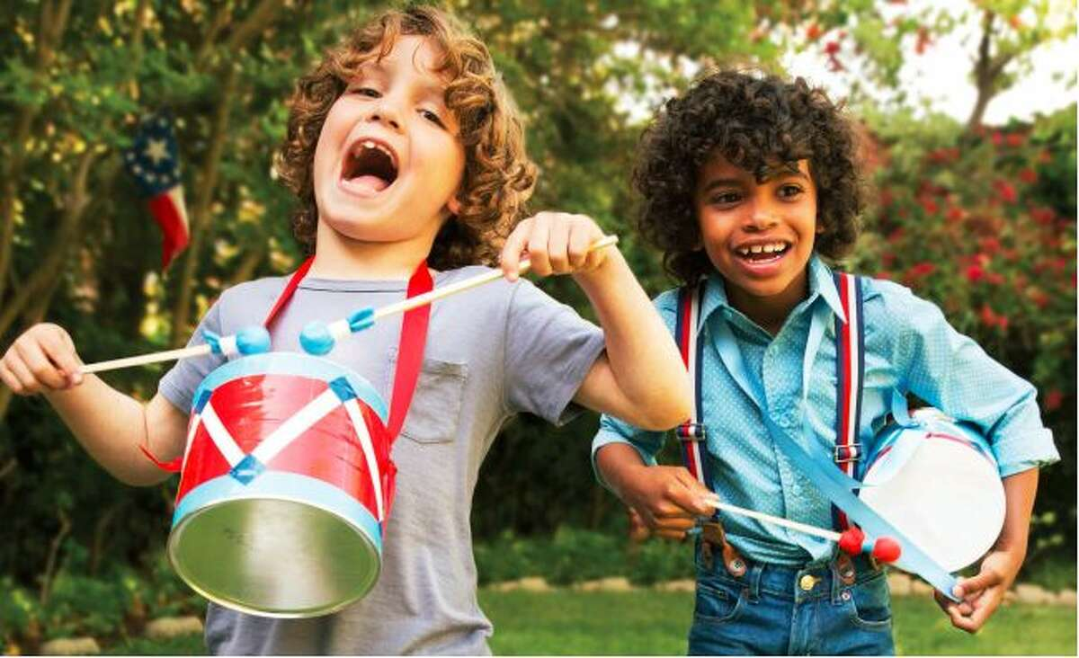 This photo provided by courtesy of FamilyFun magazine shows young boys playing with their mini-marching drums made from recycled coffee cans in a backyard.