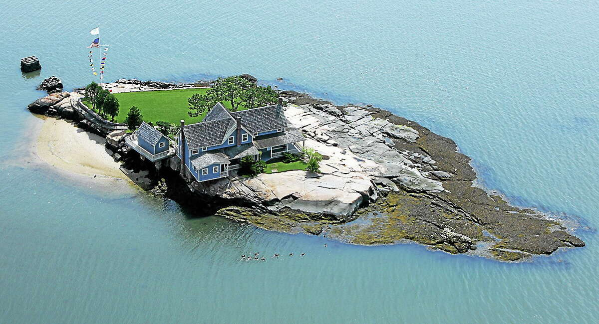 This photo released by William Pitt Sotheby's International Realty shows Belden Island, one of the Thimble Islands offshore from Branford, Conn., in Long Island Sound.