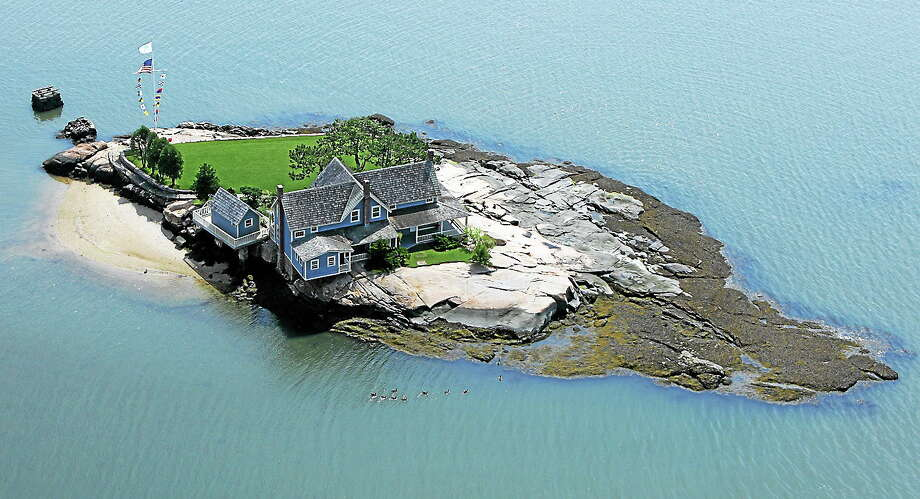 This photo released by William Pitt Sotheby's International Realty shows Belden Island, one of the Thimble Islands offshore from Branford, Conn., in Long Island Sound. Photo: AP Photo/William Pitt Sotheby's International Realty, Shoreline Aerial Photography  / Sotheby's International Realty