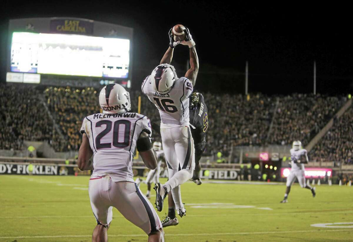 UConn's Byron Jones intercepts a pass during the Huskies' 31-21 loss to East Carolina on Thursday in Greenville, N.C.