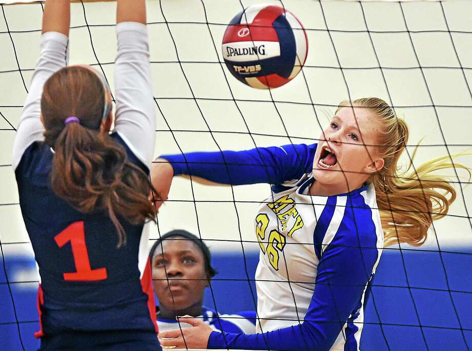 Foran's Jenna Zacarelli blocks a spike by Mercy's Casey Nelson in the CIAC quarterfinal game Tuesday. Foran won 3-1. Photo: Catherine Avalone — New Haven Register   / New Haven RegisterThe Middletown Press