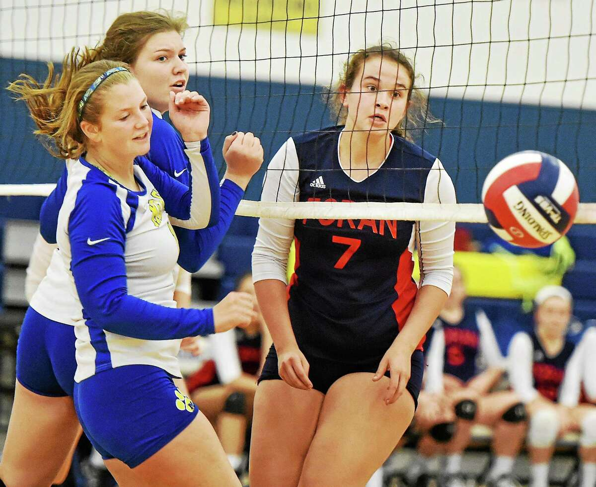 Mercy's Madeline Kumm, right, and Kiara Garrity react to the ball in the net as Foran's Janae Owen keeps her eye on the play in the CIAC quarterfinal game Tuesday.
