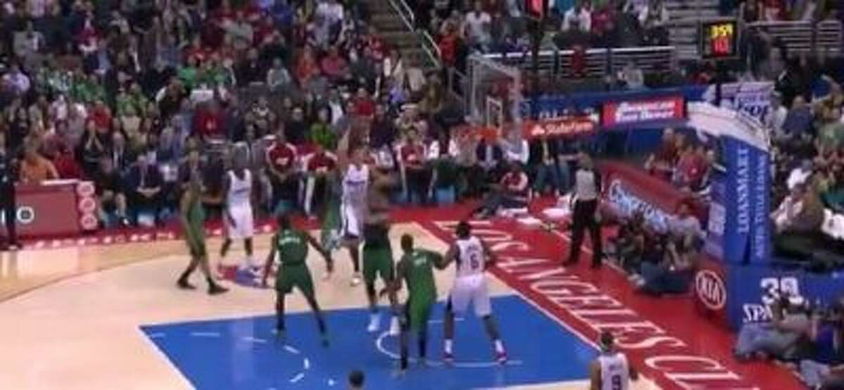 Clippers forward Blake Griffin goes right through Kris Humprhies