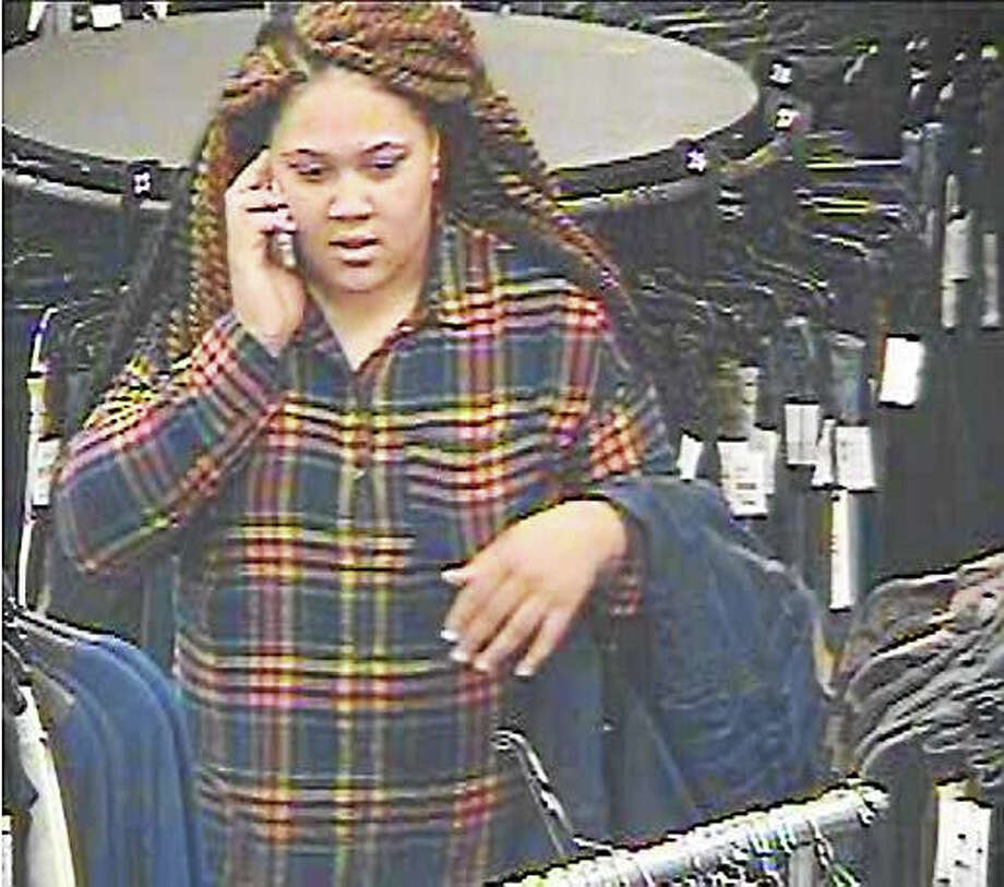 Clinton police are asking the public to help them identify a woman who allegedly stole items from a local outlet store over the weekend before fleeing in a mini-van registered in New Haven. Photo: Photo Courtesy Of The Clinton Police Department