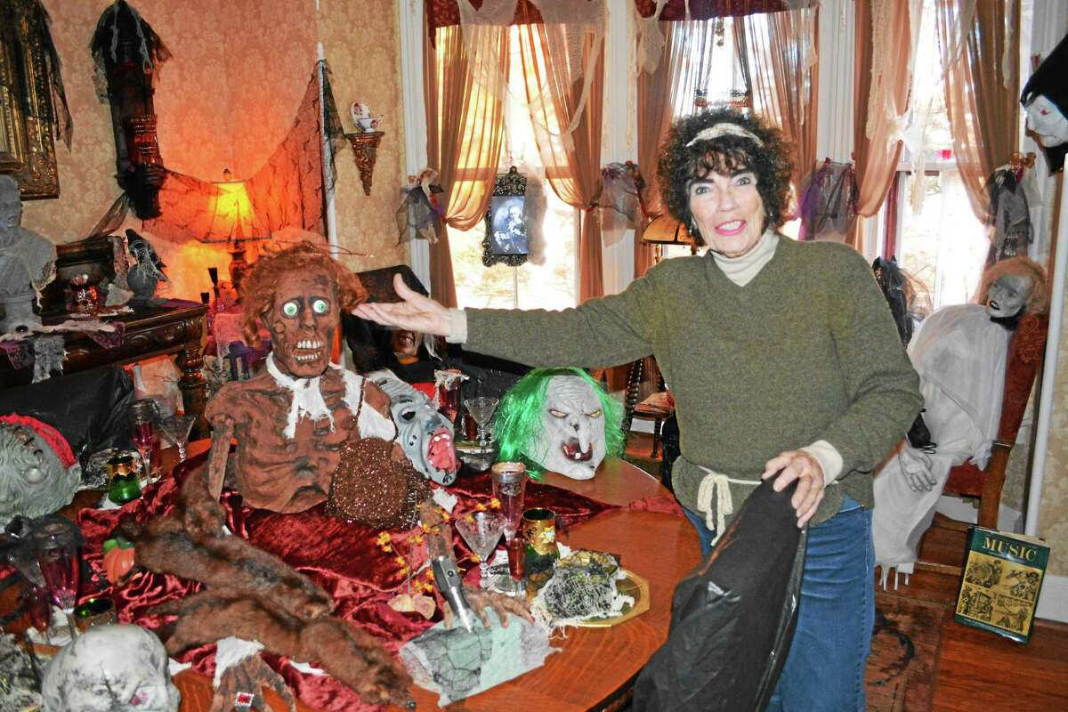 """Jude Wrinn, 80, of Middletown, has been meticulously decorating her Victorian house, inside and out, for more than 50 years. """"This is not my mother,"""" Wrinn said, adding that she painted the fearsome figure's green eyes to match the family matriarch's, created a wig made of her mother's hair, and gave the spooky gentlewoman a purse her mother hand-beaded years ago."""