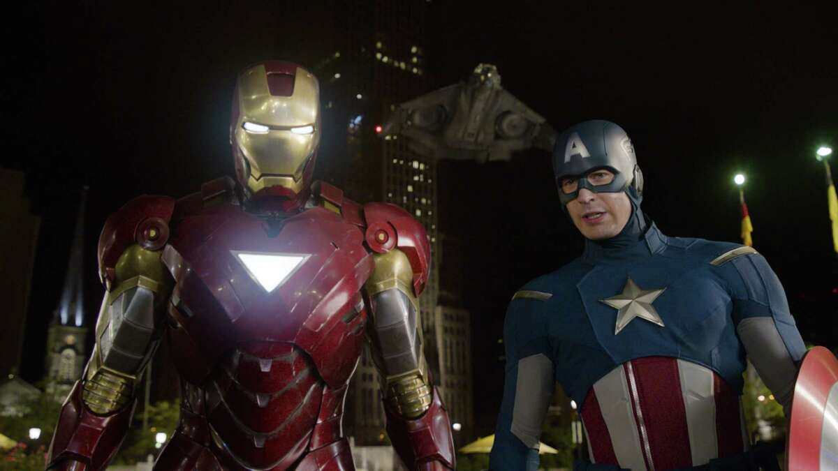 """This film image released by Disney shows, Iron Man, portrayed by Robert Downey Jr., left, and Captain America, portrayed by Chris Evans, in a scene from """"The Avengers."""" Ahead of the release of next yearís ìThe Avengers: Age of Ultronî and ìAnt-Man,î Marvel is hosting a special 45-minute presentation on Tuesday, Oct. 28, 2014, at the El Capitan Theatre in Hollywood. (AP Photo/Disney)"""