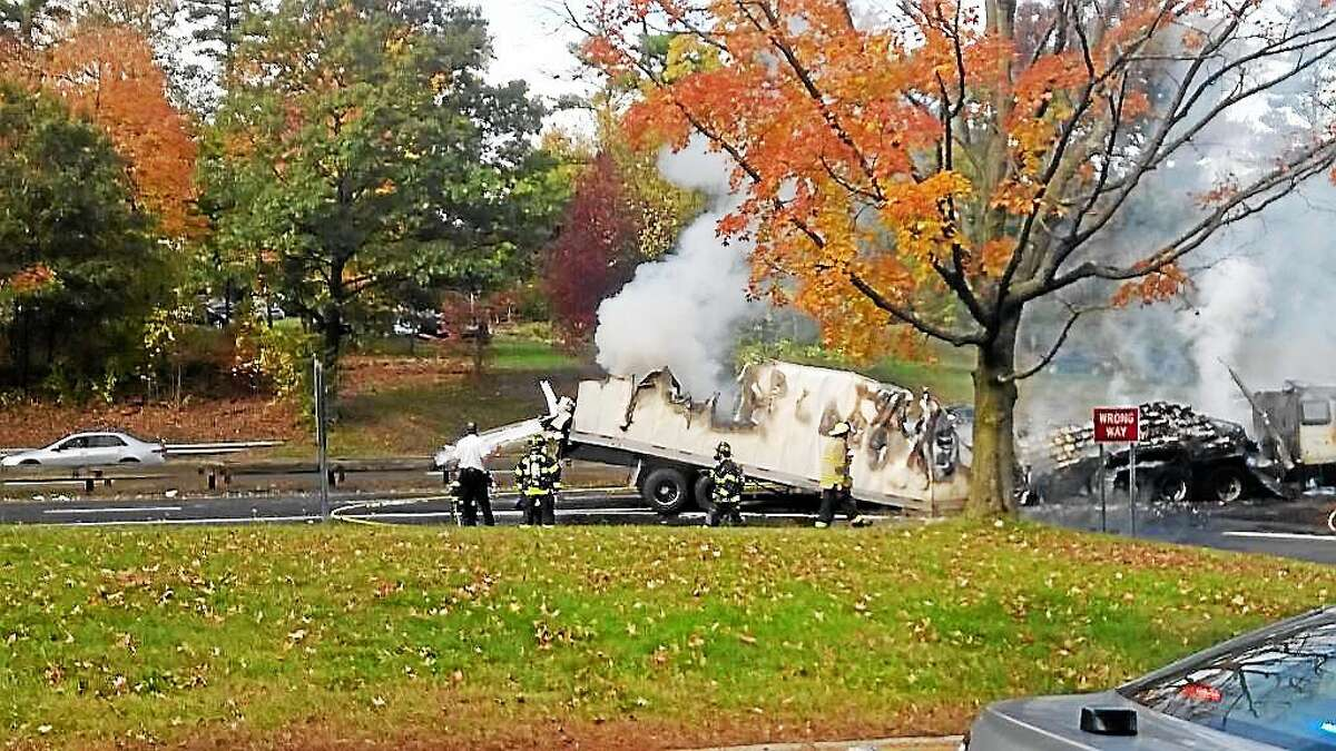 A tractor-trailer hauling butter caught fire Tuesday morning after crashing into an overpass on Route 15 near the Connecticut-New York border in Greenwich, police said. No one was injured.