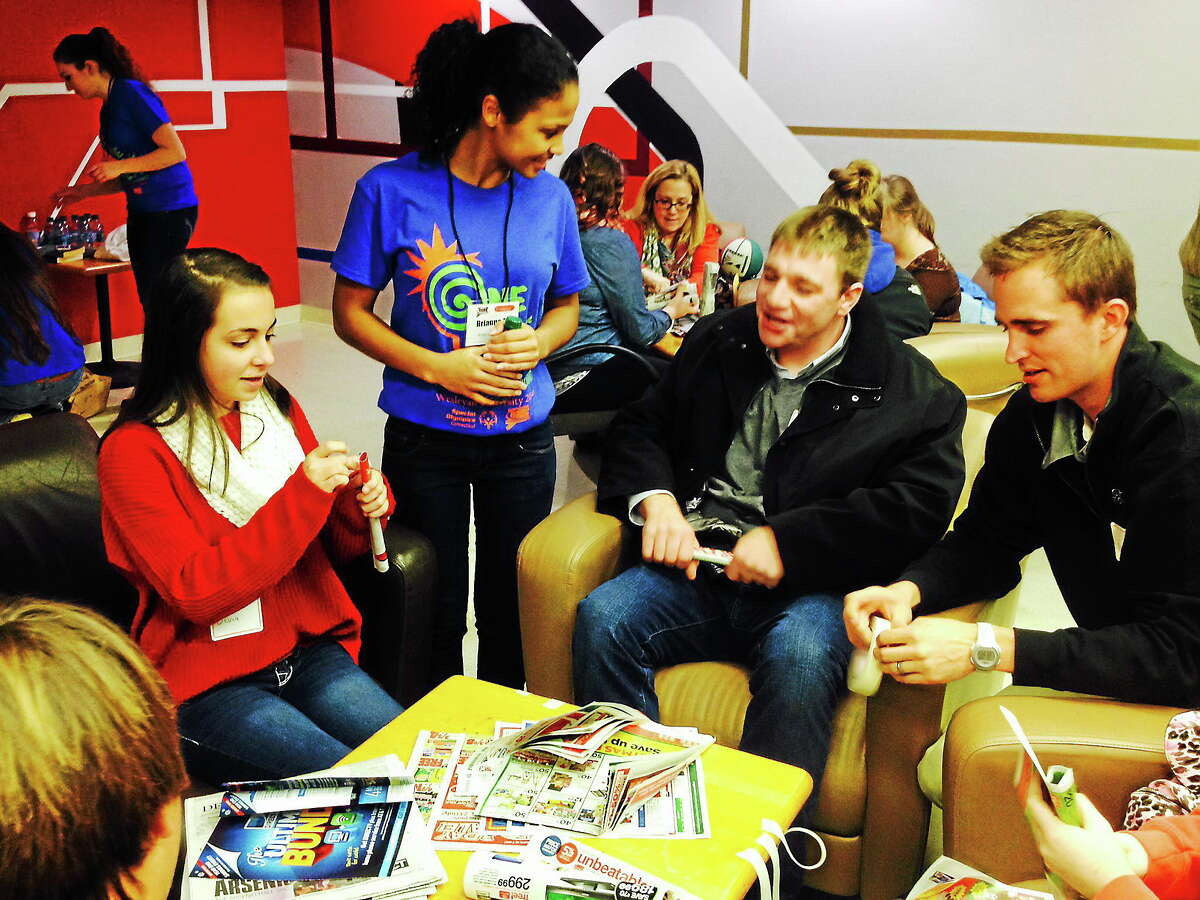 Wilby High School student Brianna Mangual, center, speaks with a group of students during a team-building workshop held as part of Thursday's Special Olympics Youth Leadership Summit at Wesleyan University in Middletown.
