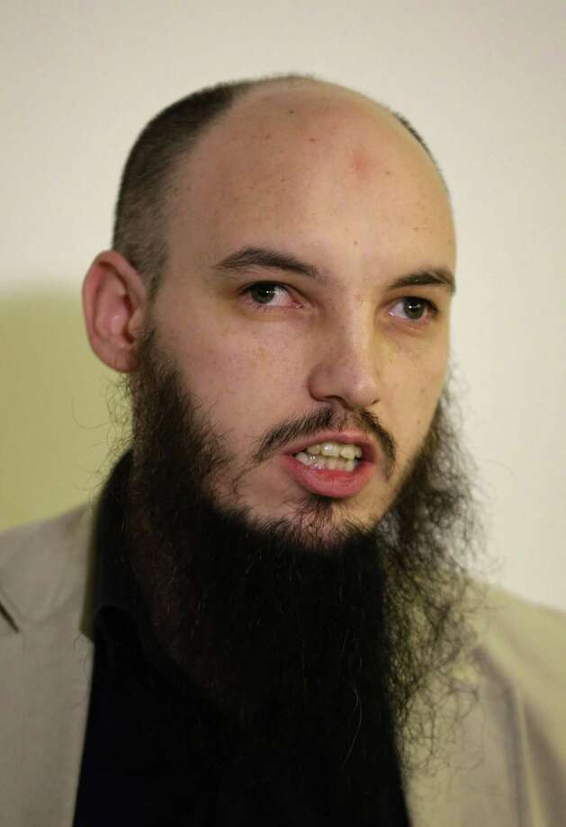 Cerie Bullivant talks at a press conference held by the CAGE human rights charity in London, Thursday, Feb. 26, 2015. A British-accented militant who has appeared in beheading videos released by the Islamic State group in Syria bears ìstriking similaritiesî to a man who grew up in London, a Muslim lobbying group said Thursday. Mohammed Emwazi has been identified by news organizations as the masked militant more commonly known as ìJihadi John.î London-based CAGE, which works with Muslims in conflict with British intelligence services, said Thursday its research director, Asim Qureshi, saw strong similarities, but because of the hood worn by the militant, ìthere was no way he could be 100 percent certain.î (AP Photo/Matt Dunham) Photo: AP / AP