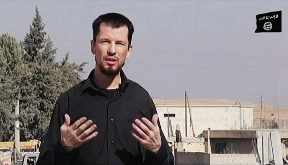In this still image taken from an undated video published on the Internet by the Islamic State group militants, captive British journalist John Cantlie speaks into a camera in what he identifies as the embattled Syrian town of Kobani. In the video, Cantlie says Islamic State fighters have pushed deeper into the town despite airstrikes by a U.S.-led coalition. It's the latest propaganda video in which Cantlie is exploited by the extremists to take on the role of a war correspondent. AP cannot verify the location independently. (AP Photo) Photo: AP / AP