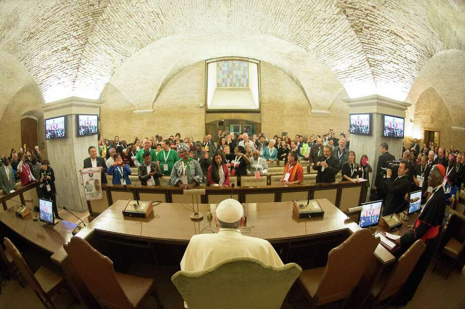 In this photo provided by the Vatican newspaper L'Osservatore Romano, Pope Francis meets with participants of the Global Meeting of Popular Movements, at the Vatican, Tuesday, Oct. 28, 2014. (AP Photo/L'Osservatore Romano) Photo: AP / L'Osservatore Romano