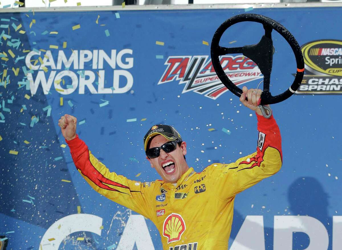 Joey Logano reacts in Victory Lane after winning the NASCAR Sprint Cup race at Talladega Superspeedway on Sunday.