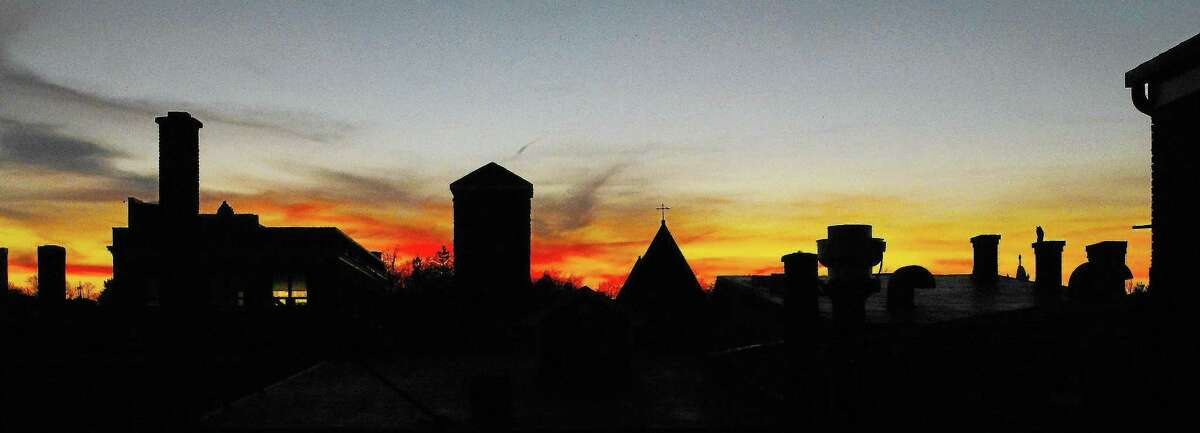 A rooftop sunset graces the Main Street skyline in Middletown in this archive photograph.