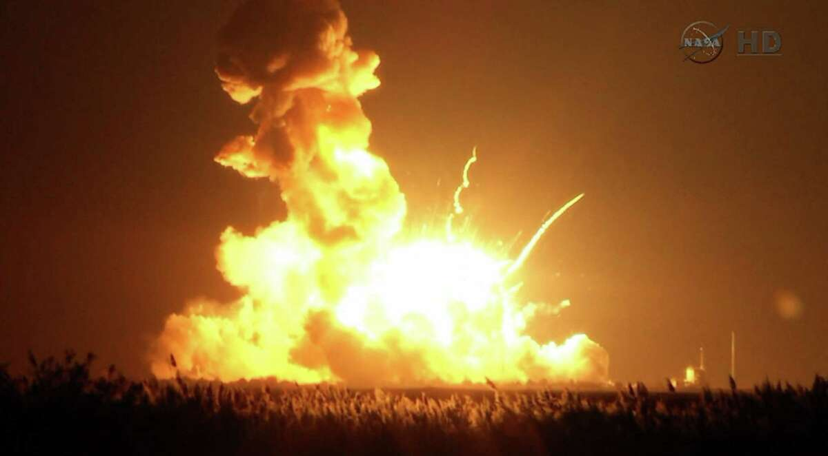 This image taken from video provided by NASA TV shows Orbital Sciences Corp.'s unmanned rocket blowing up over the launch complex at Wallops Island, Va., just six seconds after liftoff. The company says no one was believed to be hurt and the damage appeared to be limited to the facilities.