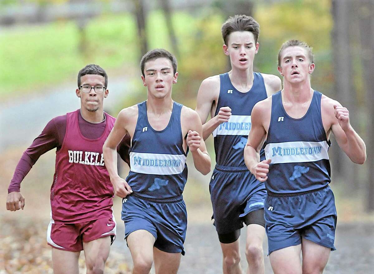 Middletown High School runners compete against Hartford's Bulkeley High School at Veteran's Memorial Park in this archive photograph.