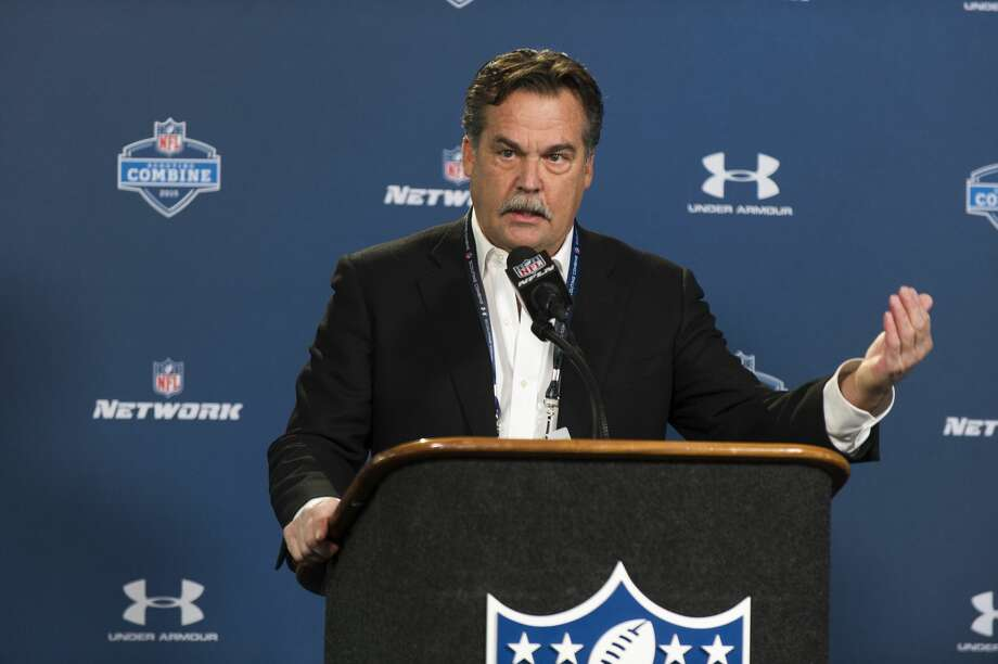 St. Louis Rams head coach Jeff Fisher talks with reporters during a news conference at the NFL scouting combine in Indianapolis on Friday. Photo: Doug McSchooler — The Associated Press  / FR170771 AP