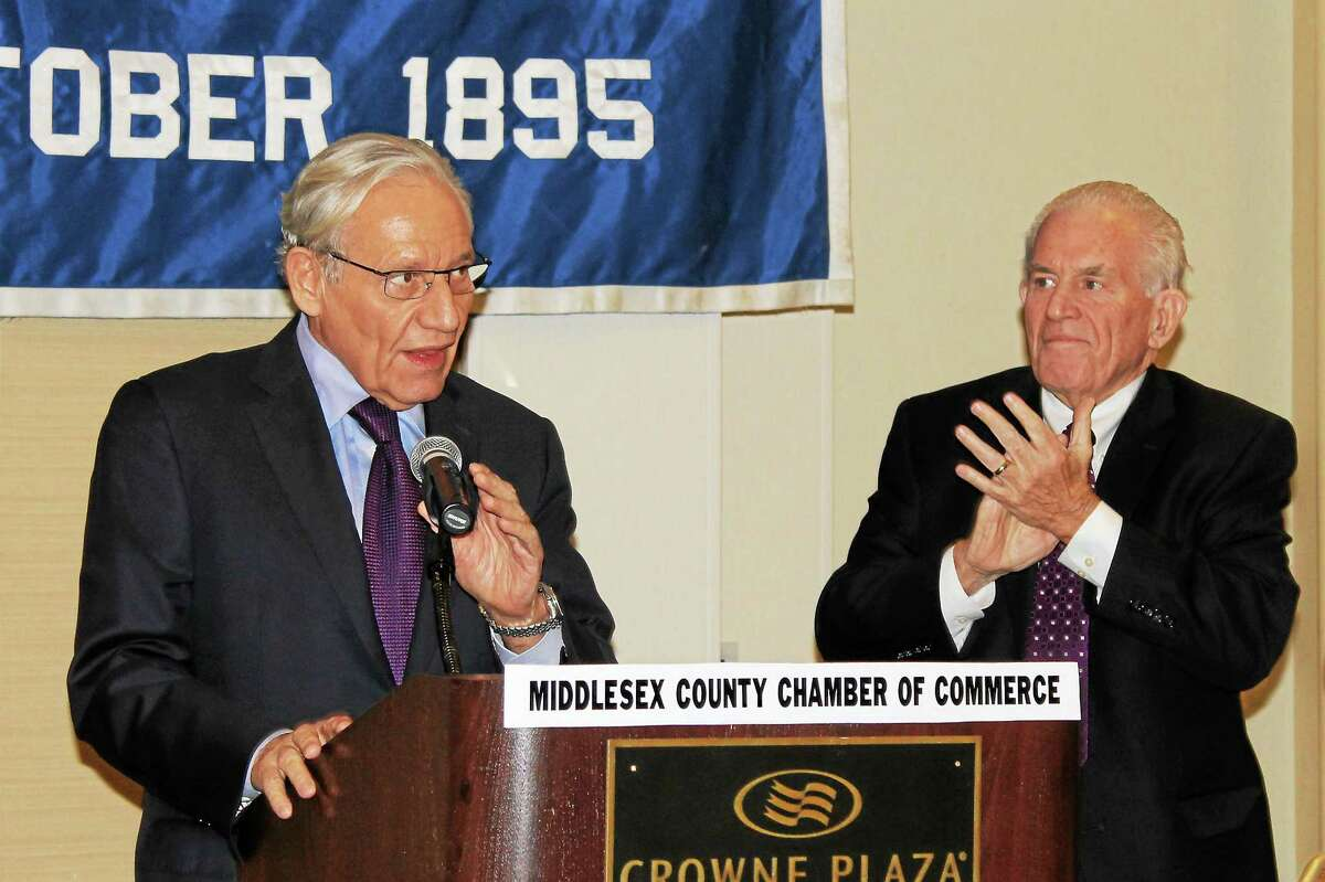 Middlesex County Chamber of Commerce President Larry McHugh, right, applauds as Bob Woodward begins his remarks at the Cromwell Crowne Plaza.