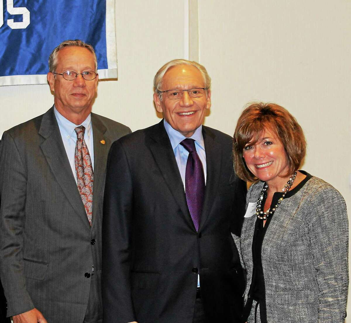 From left, Essex Savings Bank President and Chamber Vice Chairman Greg Shook, author and Washington Post investigative reporter Bob Woodward, Hospital for Special Care President and CEO Lynn Ricci are shown during the special chamber luncheon last week.