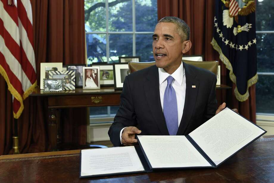 President Barack Obama vetoes the National Defense Authorization Act  on Thursday in the Oval Office of the White House in Washington. The president vetoed the sweeping $612 billion defense policy bill, citing objections over how the measure is funded. Photo: AP Photo  / AP
