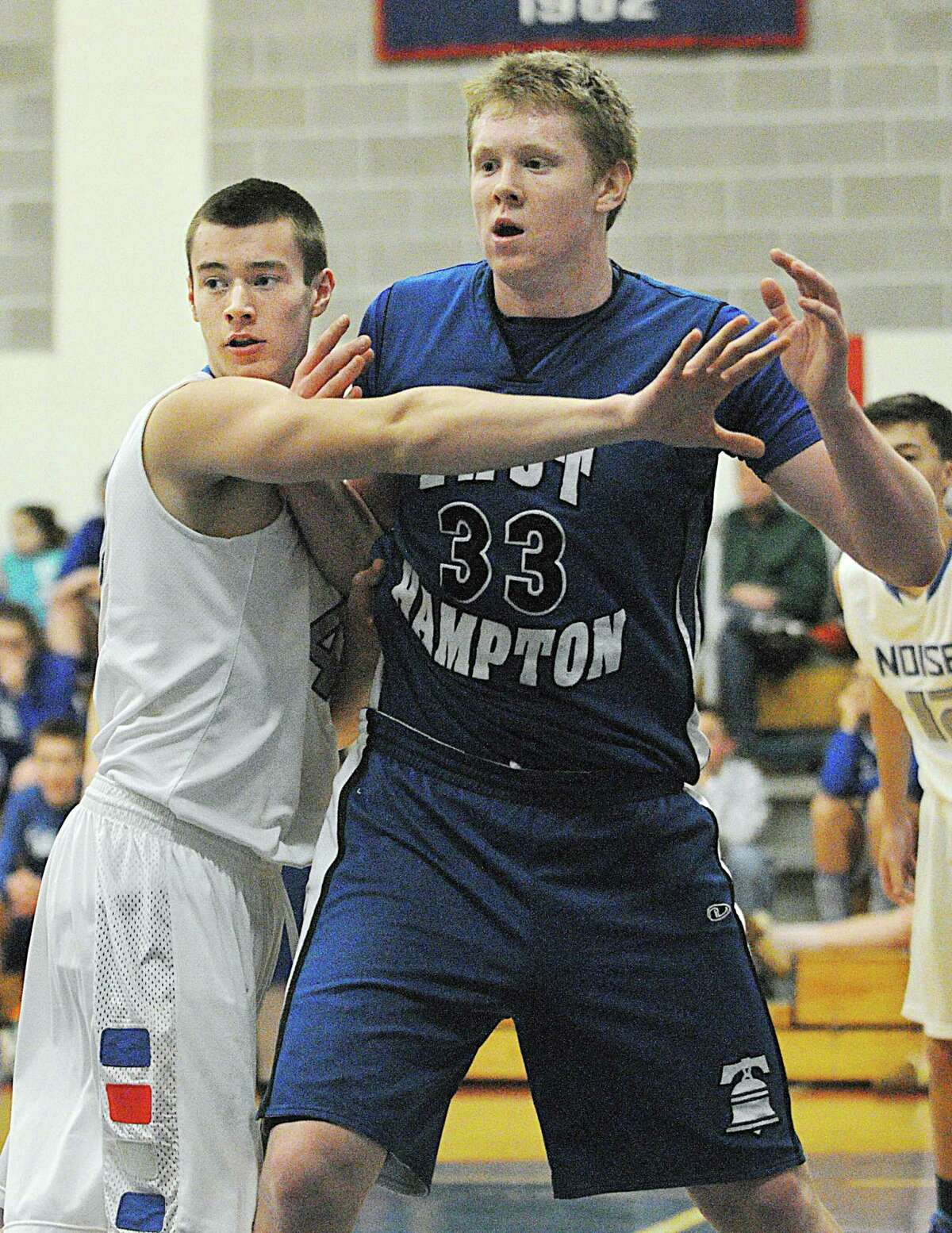 """East Hampton 6'5"""" senior forward Colin Parks takes position in the paint as Hale-Ray senior forward Brendon Fanslau defends. Parks led the Bellringers with 17 points in the 67-57 win over the Noises Tuesday evening."""