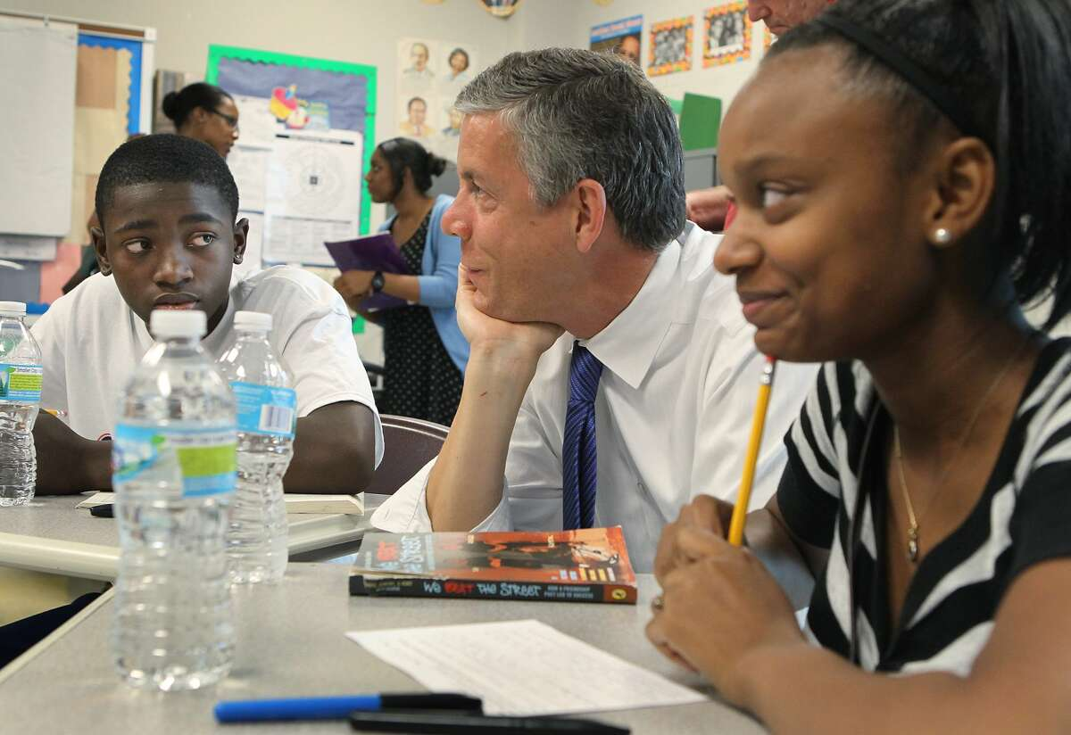 In this June 25, 2012, file photo, during a fact-finding tour of Vashon High School, then-U.S. Secretary of Education Arne Duncan, center, listens to eighth-grade students Delvion Mitchell and Makayla Lewis as they discuss social issues they have encountered at school and what they have learned from them.
