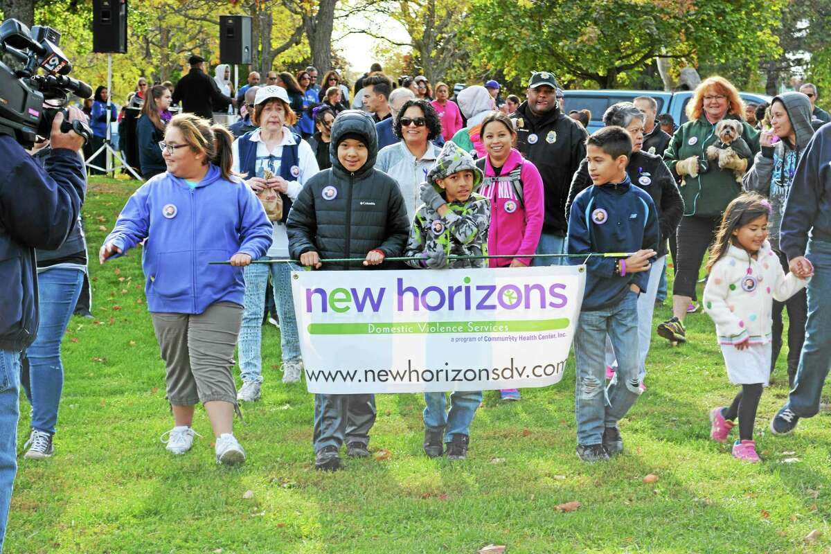 """Brisk weather didn't put off the more than 100 individuals who converged at Harbor Park Saturday morning to support the Walk to End the Silence benefit on Saturday. Middletown police and the New Horizons Domestic Violence Shelter organized the festive event, which included a disc jockey, refreshments and a Zumba workout to allow the """"athletes"""" to warm up before the 1.5-mile loop downtown. The event was held in honor of Aaden Moreno, the 17-month-old boy who lost his life in July in the Connecticut River."""