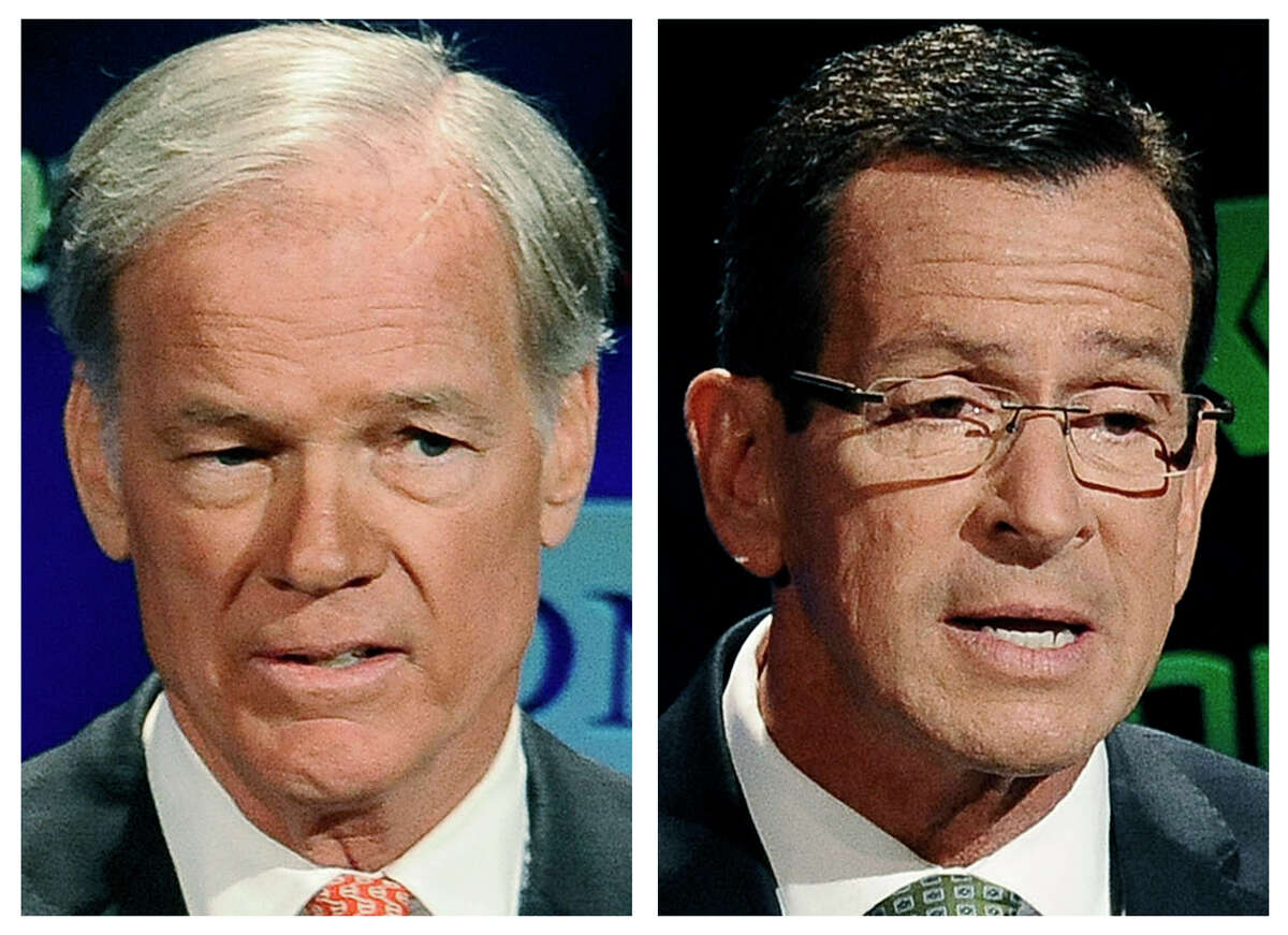 Republican candidate for governor Tom Foley, left, and incumbent Democrat Gov. Dannel P. Malloy, right, speak during a live televised debate at the University of Connecticut in Storrs, Conn. on Oct. 2, 2014.The two men will face off in the Nov. 4 general election.