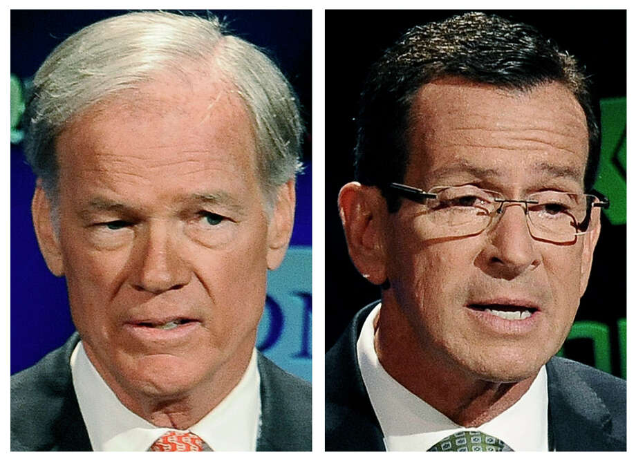 Republican candidate for governor Tom Foley, left, and incumbent Democrat Gov. Dannel P. Malloy, right, speak during a live televised debate at the University of Connecticut in Storrs, Conn. on Oct. 2, 2014.The two men will face off in the Nov. 4 general election. Photo: AP Photo/Jessica Hill, File  / FR125654 AP