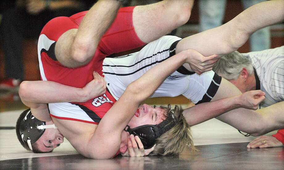 Xavier senior Quinn Marino pins Fairfield Prep junior Tsiranides Yanni at the 1:56 mark in the 145 lb. weight class Wednesday night in Middletown. Xavier won 65-6. Photo: Catherine Avalone — The Middletown Press  / TheMiddletownPress