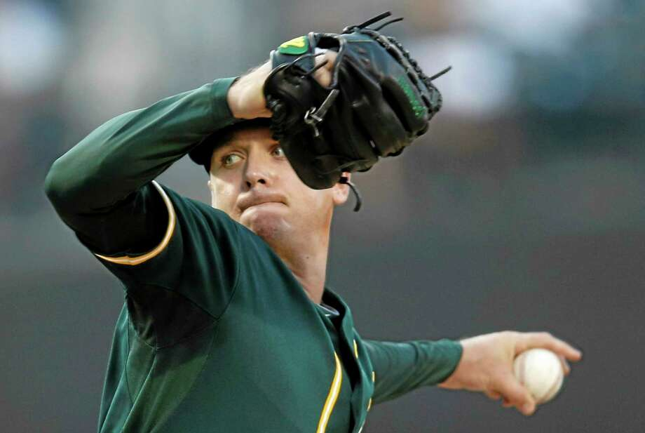 Oakland Athletics starting pitcher Scott Kazmir delivers in the first inning of Tuesday's game against the Mets in New York. Photo: Kathy Willens — The Associated Press  / AP