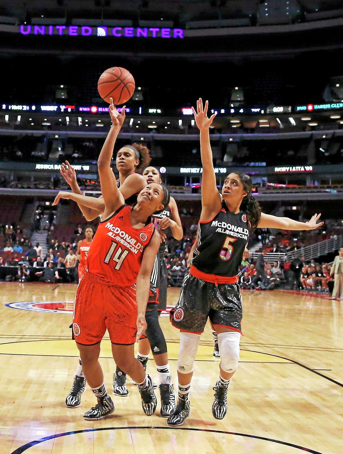 Sadie Edwards, left, gets her shot off between Brianna Turner, background, and Recee Caldwell during the McDonald's All-American game in April in Chicago.