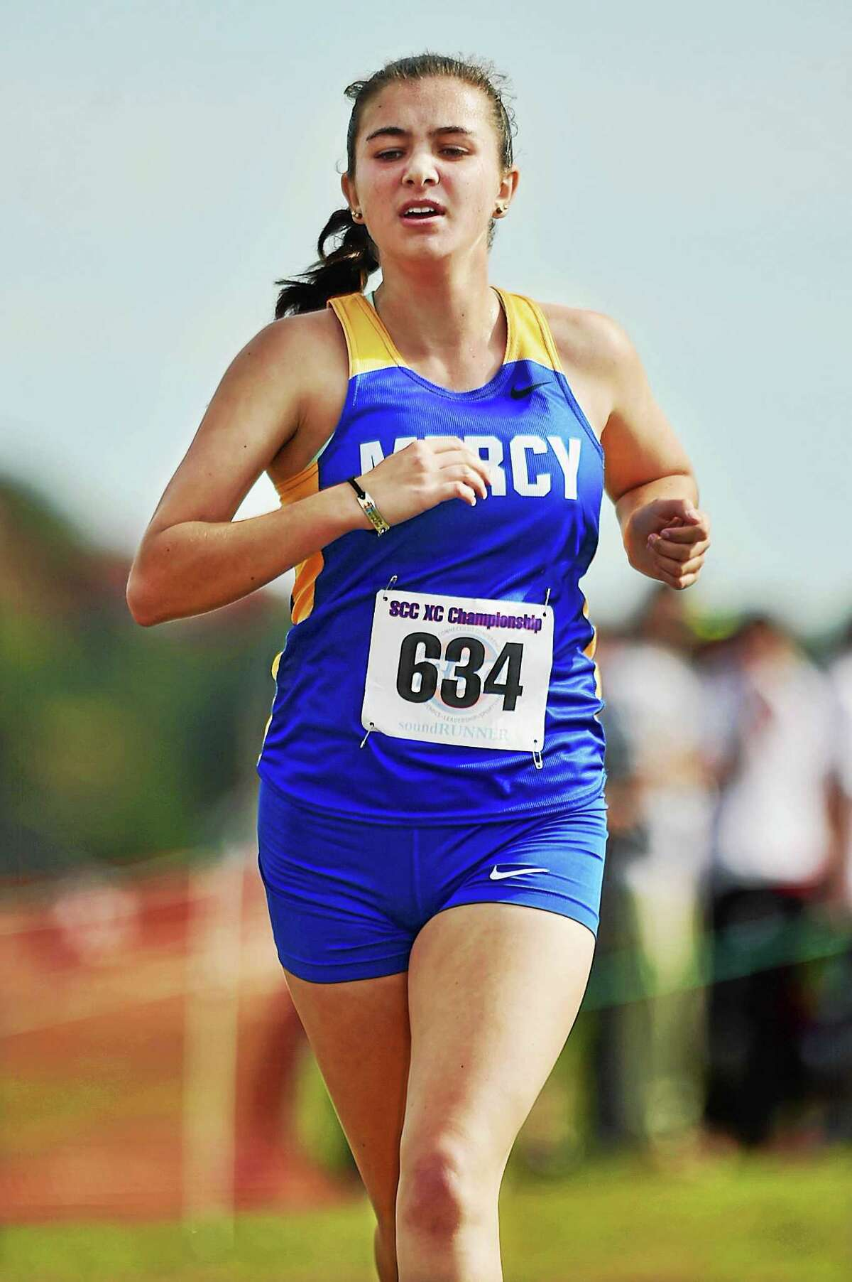 Catherine Avalone - New Haven Register Mercy's Mackenzie Pias was the top finisher in the girls' race at the Southern Connecticut Conference cross country championship Thursday at Madison.