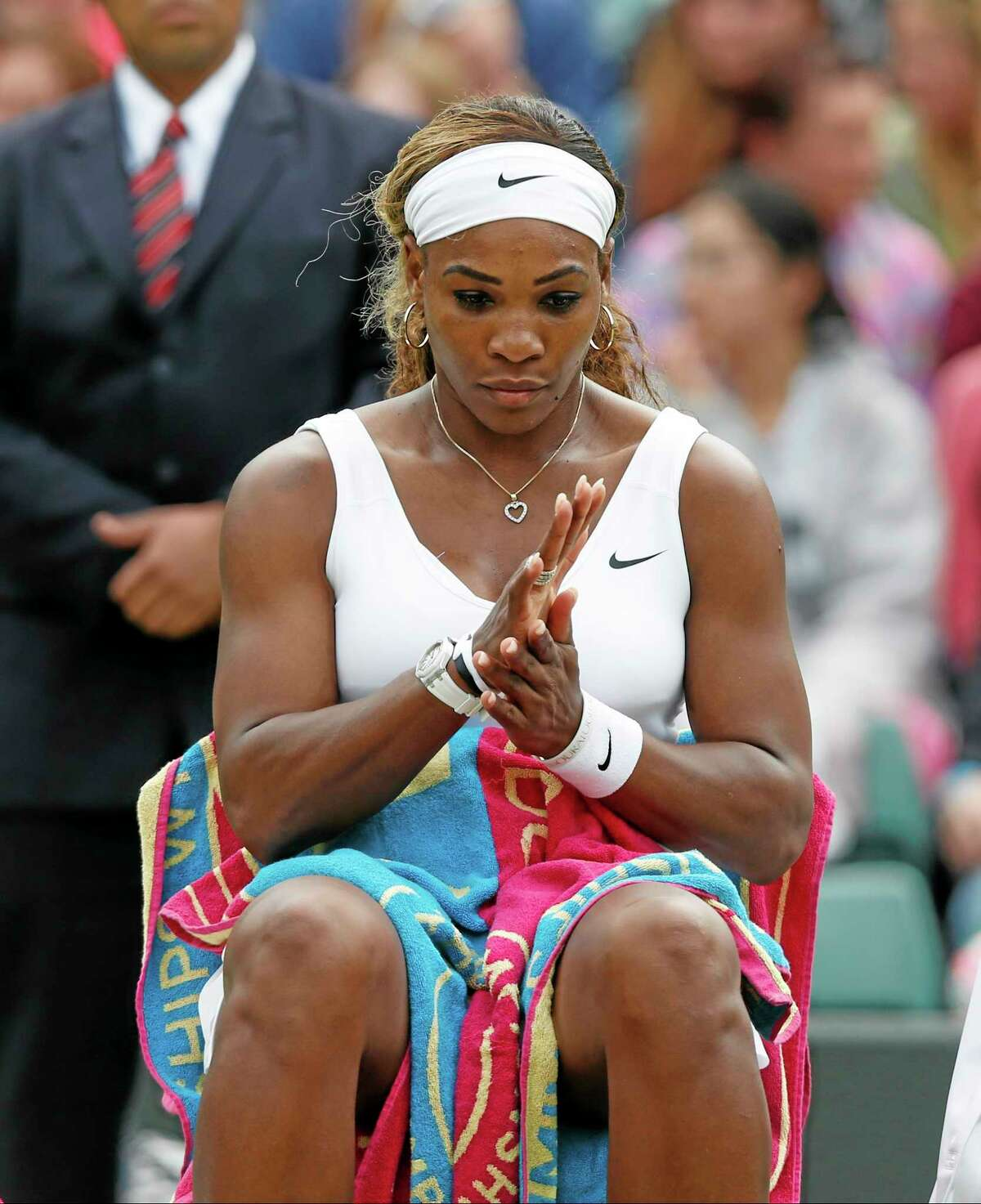 Serena Williams rests between games against Alize Cornet during their singles match Saturday at the All England Lawn Tennis Championships in Wimbledon, London.