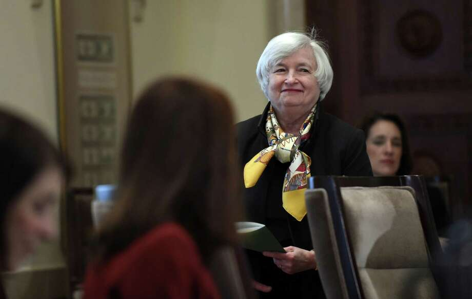 Federal Reserve Chairwoman Janet Yellen arrives for a meeting of the Board of Governors of the Federal Reserve System at the Federal Reserve in Washington on Oct. 22, 2014. The meeting was to discuss a final rulemaking requiring sponsors of securitization transactions to retain risk in those transactions. Photo: AP Photo/Susan Walsh  / AP