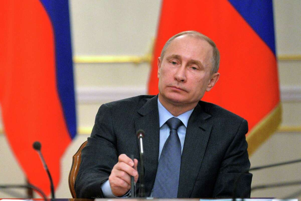 """Russian President Vladimir Putin listens during g the State Council meeting in the Novo-Ogaryovo residence, outside Moscow, Russia, Tuesday, Feb. 24, 2015. Russia denied Ukrainian and Western claims that it is supplying the rebels with troops and equipment, with the possible aim of a full-scale war. Russian President Vladimir Putin, in an interview Monday with state television, said """"such an apocalyptic scenario is hardly possible."""" (AP Photo/RIA Novosti, Alexei Druzhinin, Presidential Press Service)"""