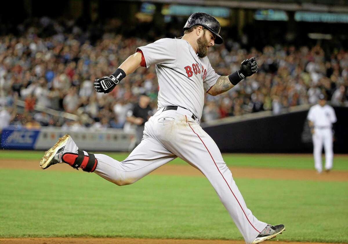 Boston's Mike Napoli rounds first base after hitting a solo home run against the Yankees in the ninth inning Saturday in New York. The Red Sox won 2-1.