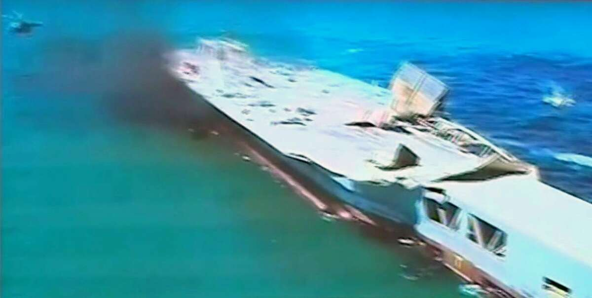 """This image taken from Iranian state TV, shows footage of damage to a mock U.S. aircraft carrier during large-scale naval and air defense drills by Iran's Revolutionary Guard, near the Strait of Hormuz, Iran, Wednesday, Feb. 25, 2015. The drill, named Great Prophet 9, was the first to involve a replica of a U.S. carrier. Cmdr. Kevin Stephens, the spokesman for the U.S. Navy's 5th Fleet in Bahrain, said they were monitoring the drills, but downplayed the simulated attack on the carrier, saying the U.S. military was """"not concerned about this exercise."""""""