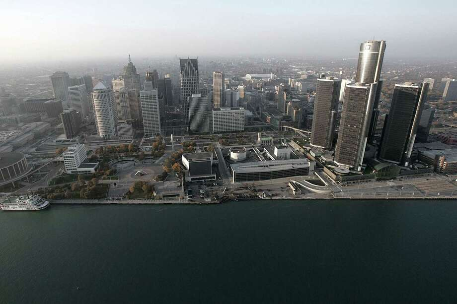 The Detroit skyline is shown along the Detroit River. Lawyers began making their closing arguments on Oct. 27, 2014 in Detroit's bankruptcy trial. Detroit filed for Chapter 9 bankruptcy protection in July 2013, becoming the largest U.S. city to ever do so. Photo: AP Photo/Paul Sancya, File  / AP