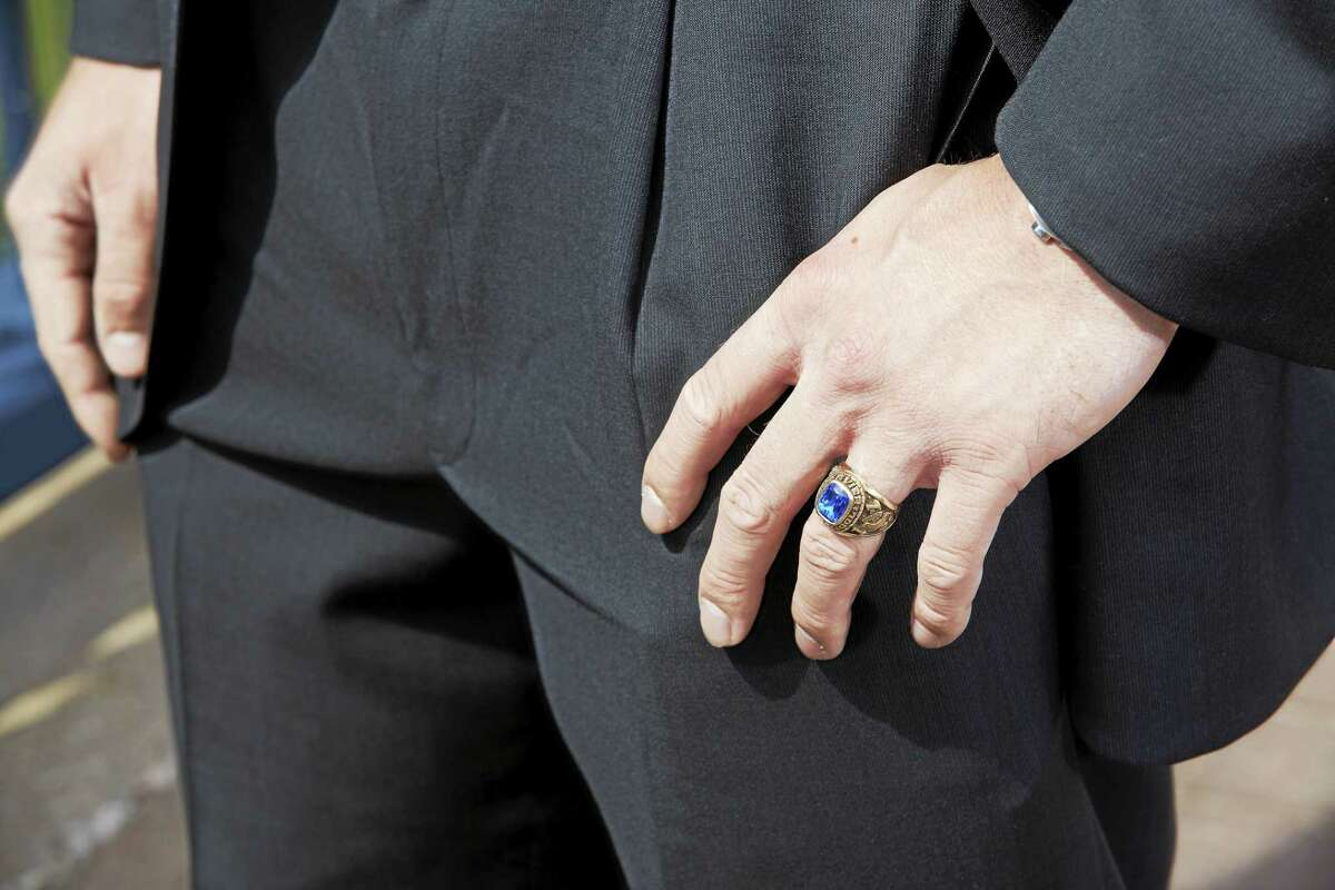 Mackiewicz, who graduated from Xavier High School in Middletown, wears his class ring from 2011.