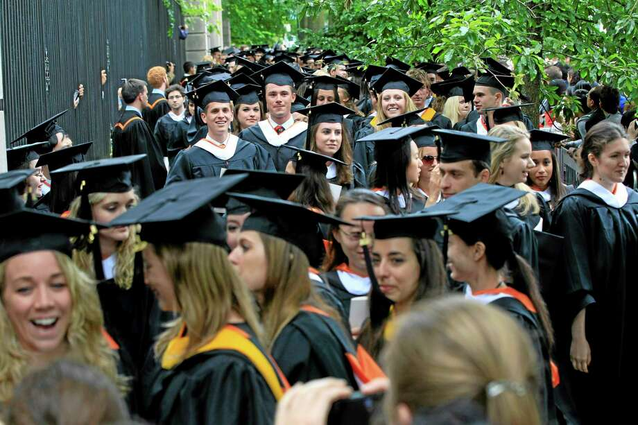 In this Tuesday, June 5, 2012 photo, friends and family greet a procession of the graduating class of 2012 at Princeton University after commencement ceremonies in Princeton, N.J. Photo: Mel Evans — The Associated Press / AP
