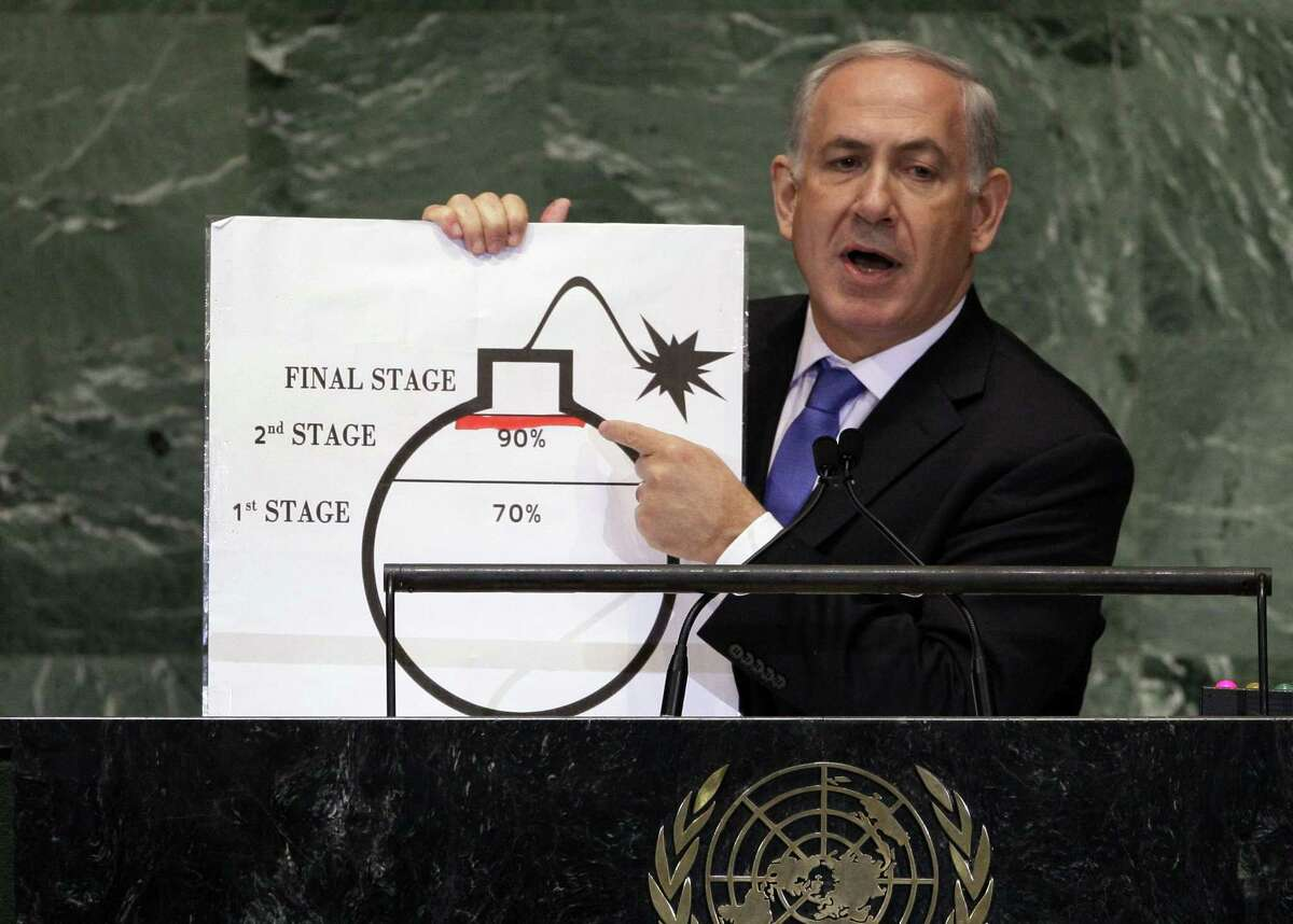 """FILE - In this Thursday, Sept. 27, 2015 file photo, Israeli Prime Minister Benjamin Netanyahu shows an illustration as he describes his concerns over Iran's nuclear ambitions during his address to the 67th session of the United Nations General Assembly at U.N. headquarters. In his sharpest criticism yet, Israeli Prime Minister Benjamin Netanyahu said Wednesday, Feb. 25, 2015 that world powers """"have given up"""" on stopping Iran from developing nuclear weapons in ongoing negotiations.(AP Photo/Richard Drew, File)"""